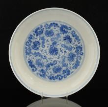Chinese blue and white dish decorated with scrolli