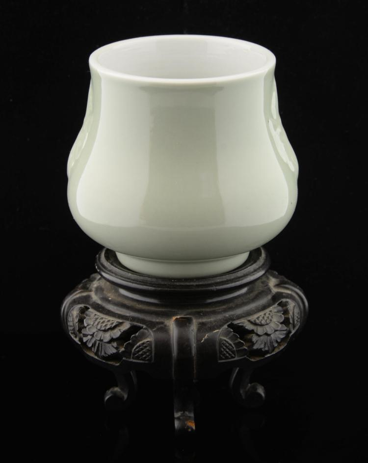 Chinese celadon glazed bulbous vase with moulded i