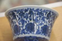 Chinese blue and white stem cup with stylized foli