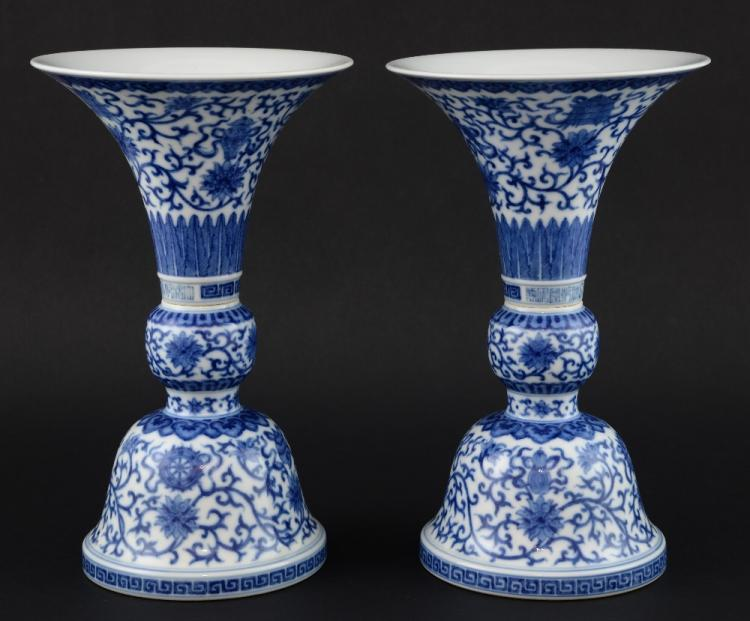 Pair of Chinese blue and white two section vases w
