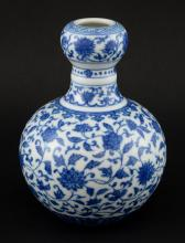 Chinese bulbous blue and white vase with floral de
