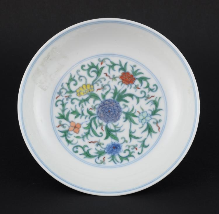 Chinese doucai saucer dish with floral decoration,