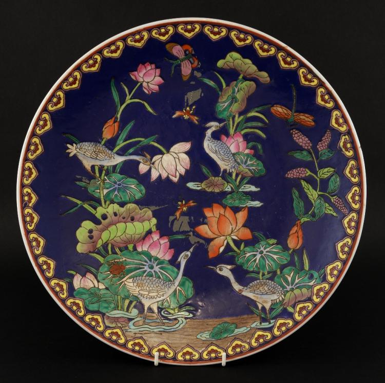 Chinese blue ground dish decorated in colours with