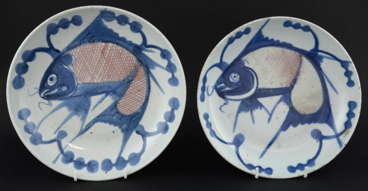 Two Chinese blue, red and white fish decorated dis