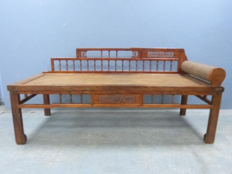 Chinese day bed with raised spindle back and ratta