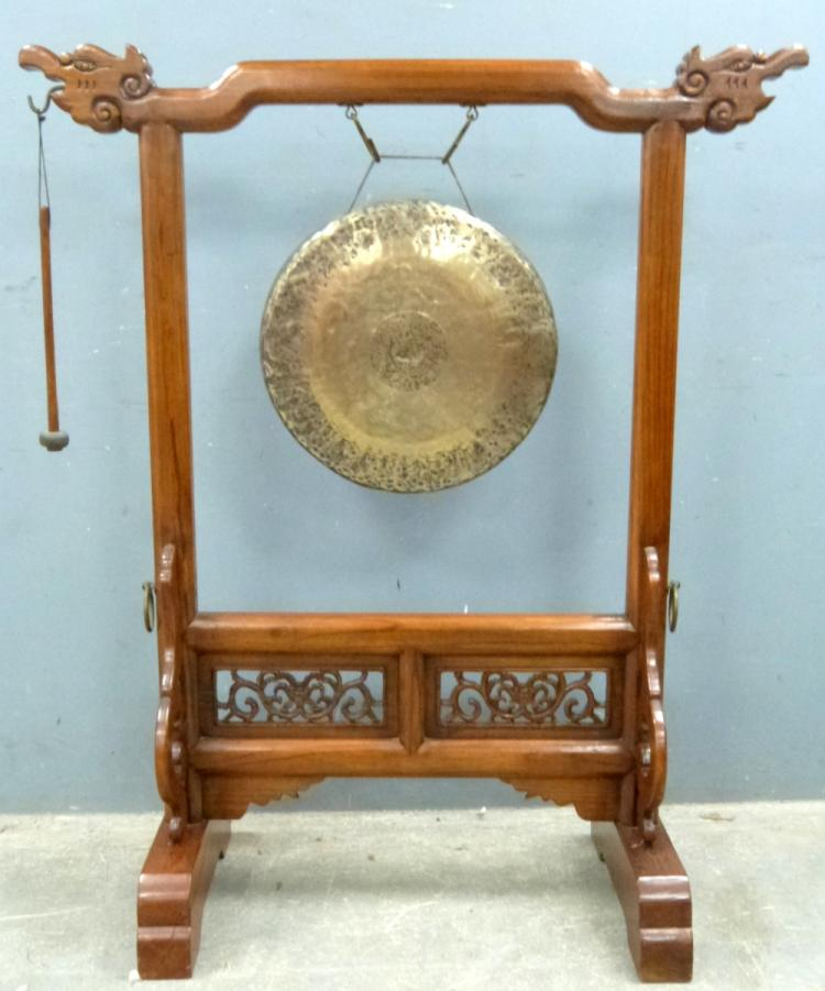 Chinese brass gong on carved elm stand, overall 12
