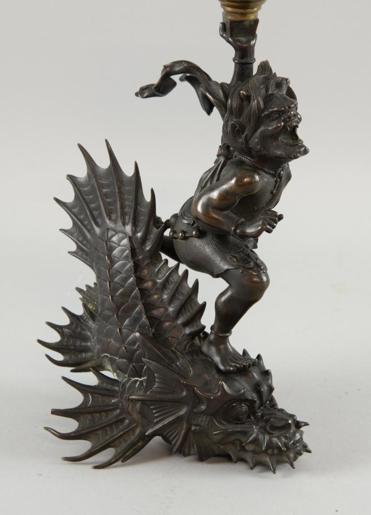Japanese cast bronze Oni riding on the back of a s