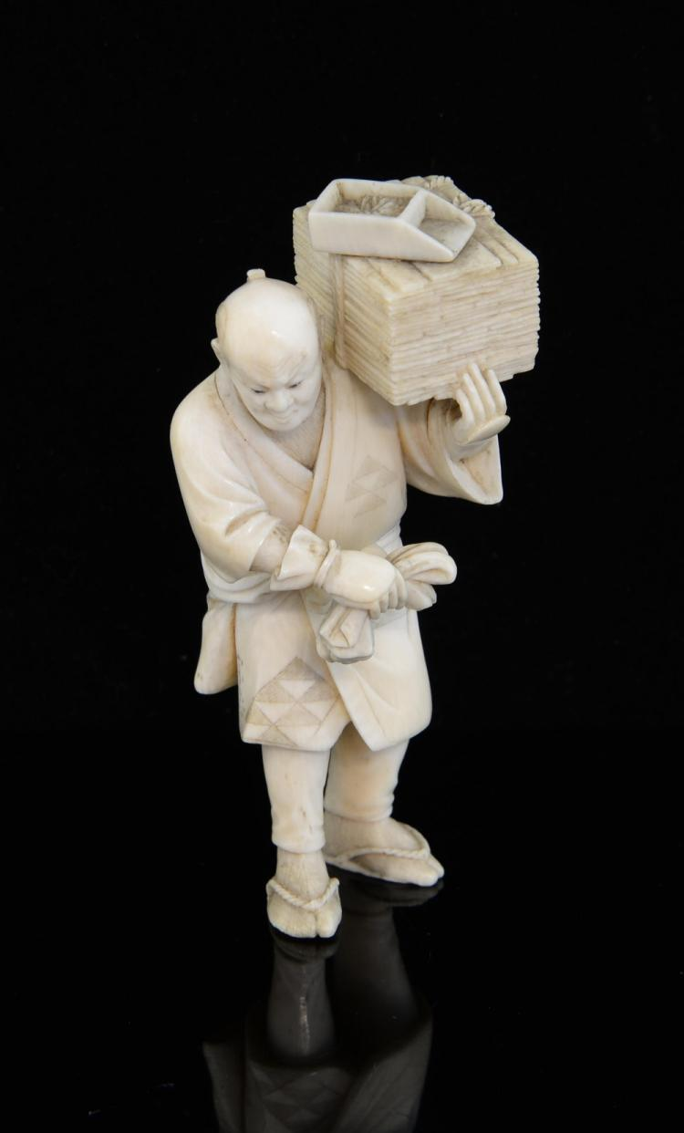Early 20th century Japanese ivory okimono of a man