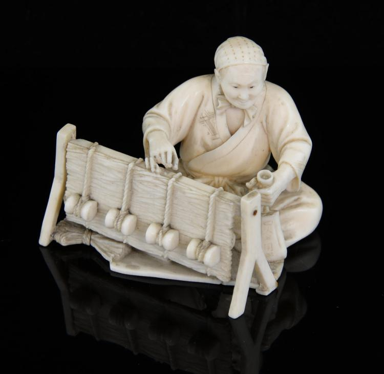 Early 20th century Japanese ivory okimono of a sea