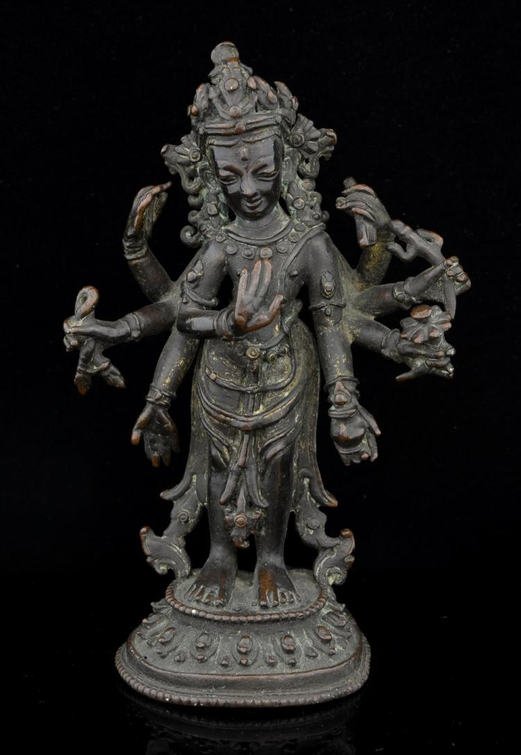 Indian bronze eight-armed deity, six of the hands