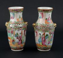 Pair of 19th century Canton enamel vases painted with panels of figures, butterflies and flowers, 16cm high,