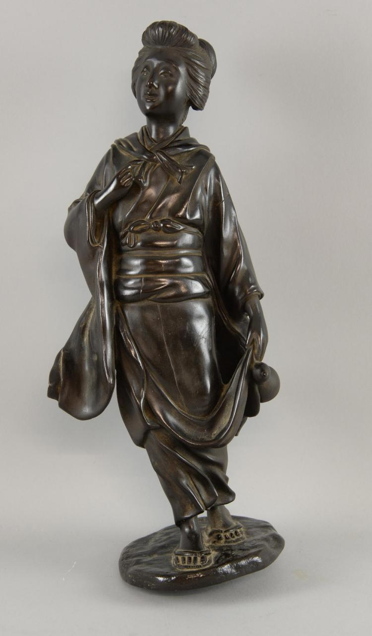 Japanese bronze figure of a standing woman, signed