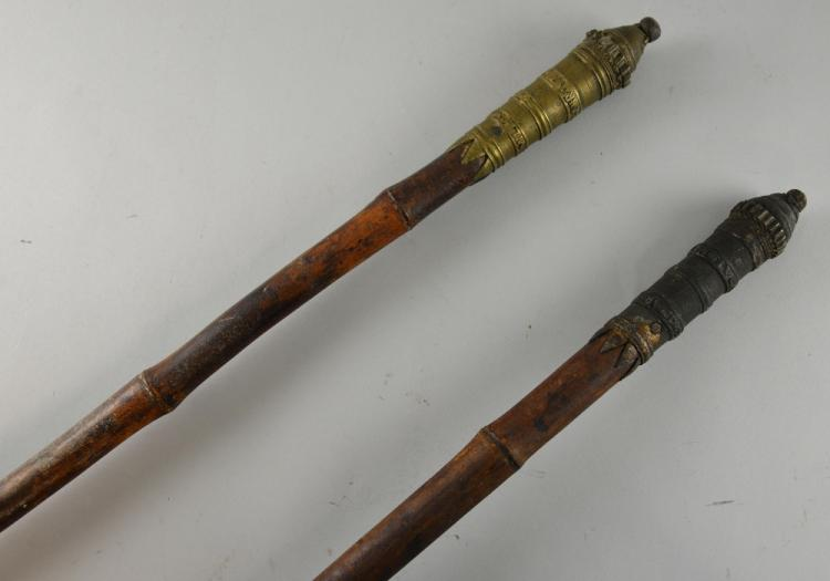 Pair of bamboo ceremonial canes with metal finials