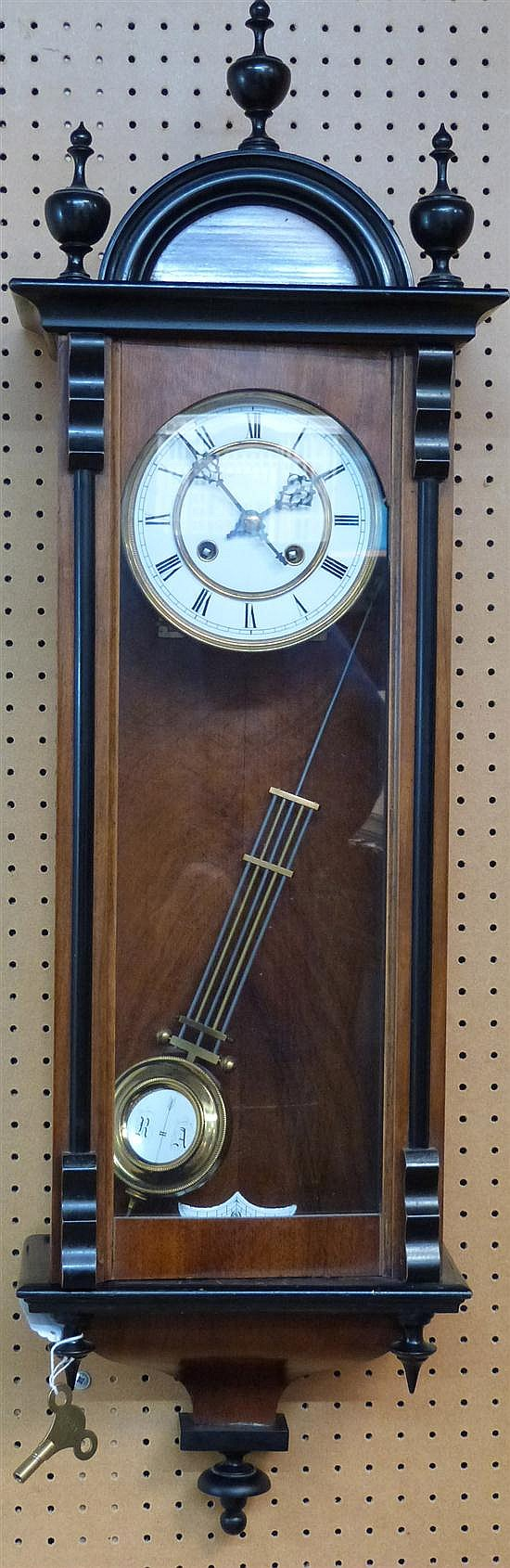 German walnut and ebonized wall clock