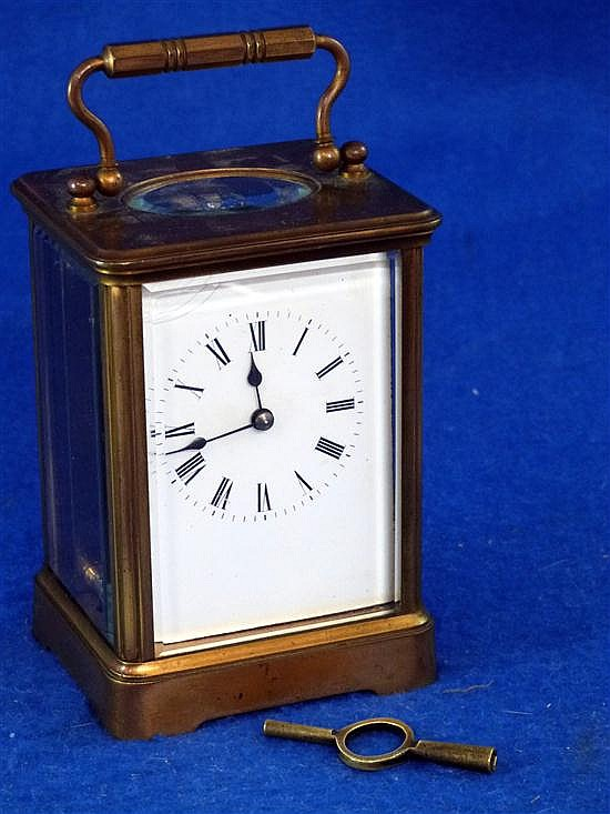 Brass and glass carriage clock with lever movement