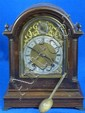 Early twentieth century oak cased bracket clock with brass dial and silvered chaptering and twin train movement
