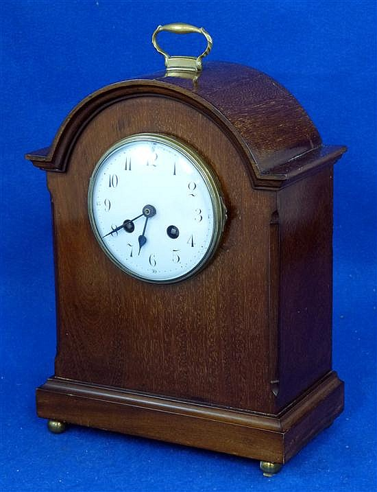 Edwardian mahogany mantel clock with eight day movement, white enamel dial, on brass ball feet