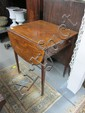 19th century mahogany and crossbanded Pembroke table with frieze drawer, on tapering legs and brass castors,