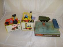 A group of Dinky toys to include a boxed Dinky Aveling-Darford Diesel Roller, a boxed Dinky fork lift truck and a boxed task force set (incomplete - 1 vehicle missing) F-G in F -G boxes
