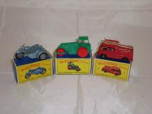 A group of three Matchbox Lesney vehicles to include a number 4 motorcycle with sidecar, a number 1 steam roller and a number 9 fire truck.  G-VG in F-G boxes (3)