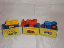 A groupf of three Matchbox Lesney vehicles to include a number 8 Caterpillar Truck, A number 58 Digger and a Number 72 Tractor.  G-VG in F-G boxes (3)