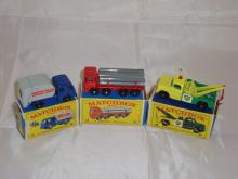 A group of three Matchbox Lesney vehclces to include a number 15 refuse truck, a number 10 lorry with pipe load and a number 13 breakdown truck.  G-VG in P-G boxes (3)