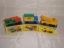 A group of Matchbox construction vehicles to include a number 30 , a number 60 and a number 63. G-VG in G boxes (3)