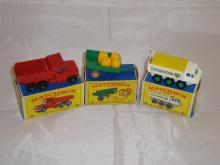A group of three Matchbox vehicles to include a number 48 dumper truck, a number 61 trailer and a number 61 BP exploration truck.  G-VG in G boxes (3)