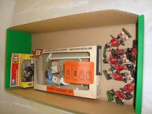 A group of Britains diecast toys to include a boxed garage forecourt set, a boxed motorcyle and a collection of lead soldiers by unknown manufacturer. F-G in F-G boxes where boxed