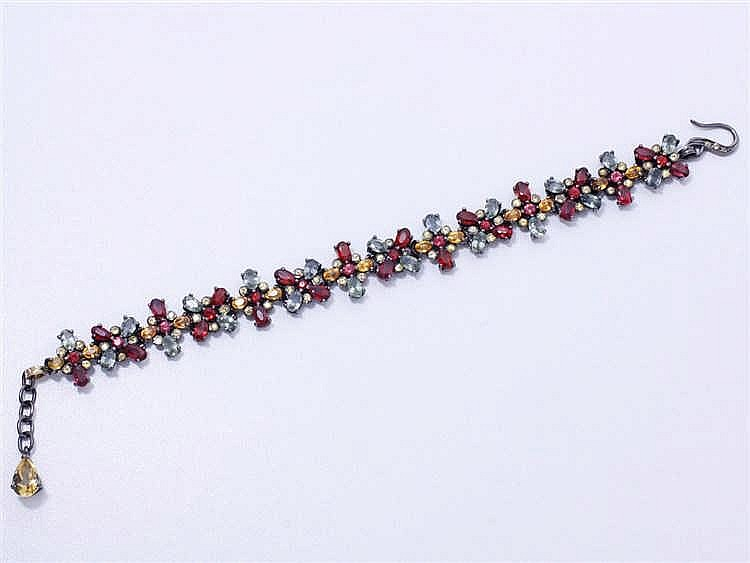 Bracelet souple en argent 800 millièmes, composé de maillons à motif floral