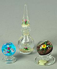 Two Small Paperweights on Stands