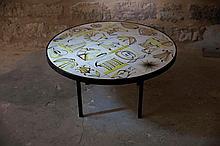 Roger CAPRON (1922-2006)  Table basse circulaire  circa 1960  Bâti en acier laqué noir et plateaux de carreaux de céramique polychrome à décors d'animaux, signée