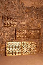 Jules CAYETTE (1882-1953)  Suite de cinq panneaux  circa 1925  En laiton doré, à décor au repousséde scarabées dans des mandorles ajourées, l'un signé.