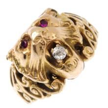 A late Victorian gold ruby and diamond lion ring. Designed as a lion mask,