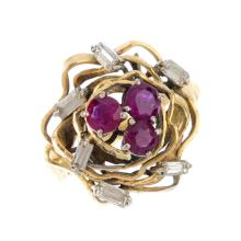 A ruby and diamond cluster ring. The circular-shape ruby trefoil, with bagu