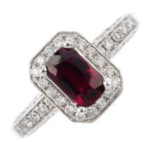 A ruby and diamond dress ring. The rectangular-shape ruby, with a brilliant