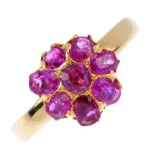 A 9ct gold ruby floral cluster ring. The vari-shape ruby floral cluster, wi