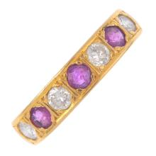 An 18ct gold diamond and ruby seven-stone ring. The alternating brilliant-c