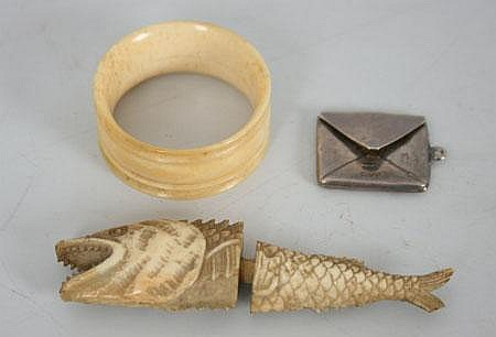 A Carved Bone Needle Case Modelled As A Fish A