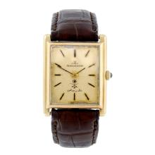 JAEGER-LECOULTRE - a gentleman's yellow metal wrist watch.