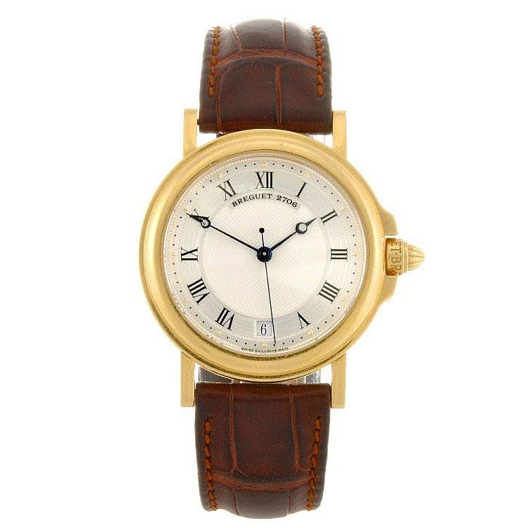 An 18k gold automatic gentleman's Breguet wrist watch.
