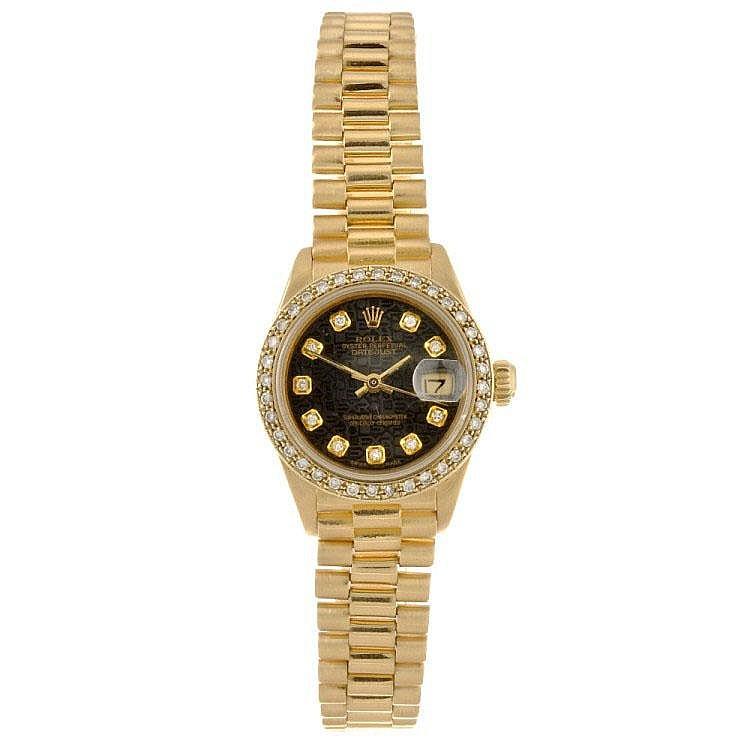 An 18k gold automatic lady's Rolex Datejust bracelet watch.