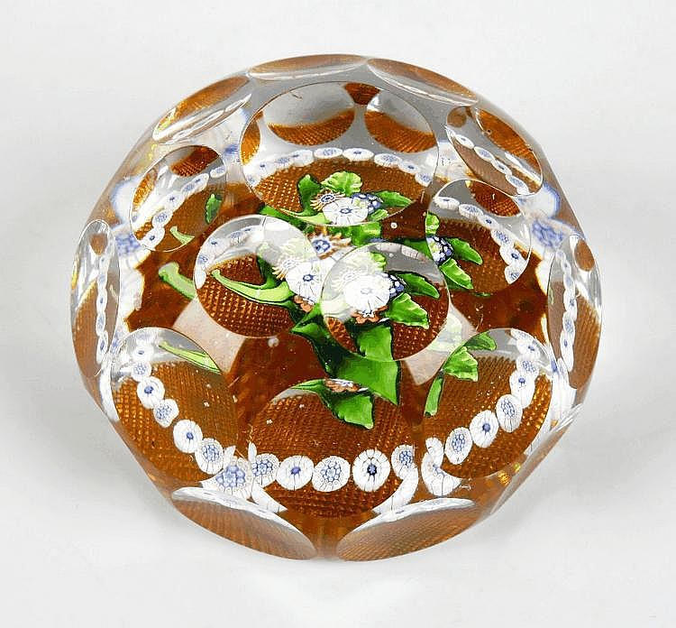 A facetted glass millefiori paperweight