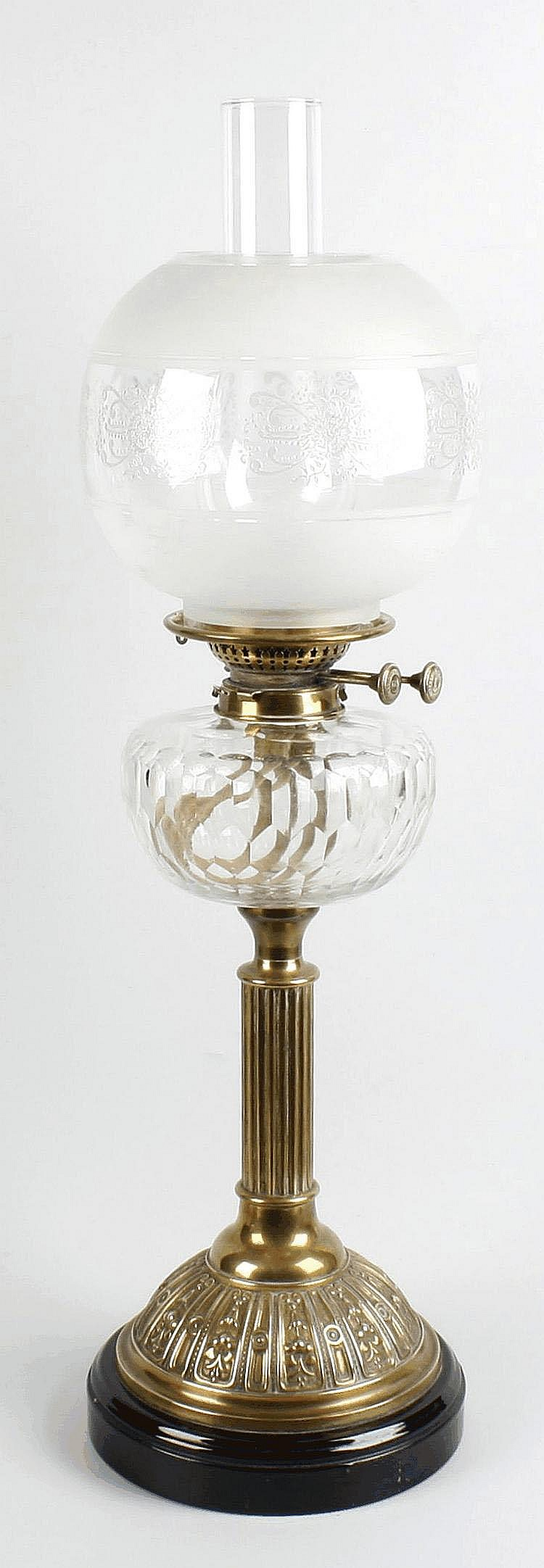 19th century oil lamp with glass reservoir lamp shade and chimney.