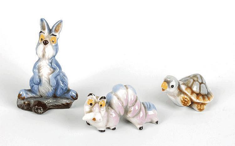 Three Wade Disney 'Sword in the Stone' hat box figures