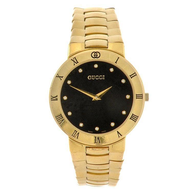 4ca9d0740 A gold plated quartz gentleman s Gucci 3300.2M bracelet watch.
