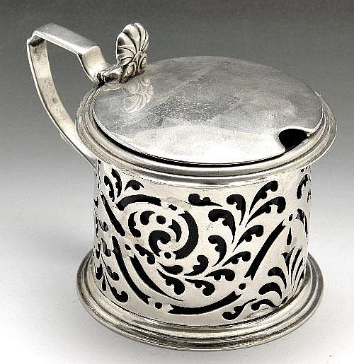 A large Victorian silver mustard pot.