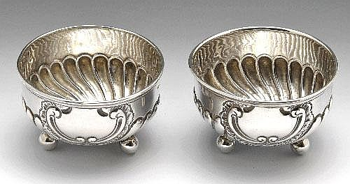 A pair of silver salts, a shell dish, butter knife and a Georgian sifter spoon.