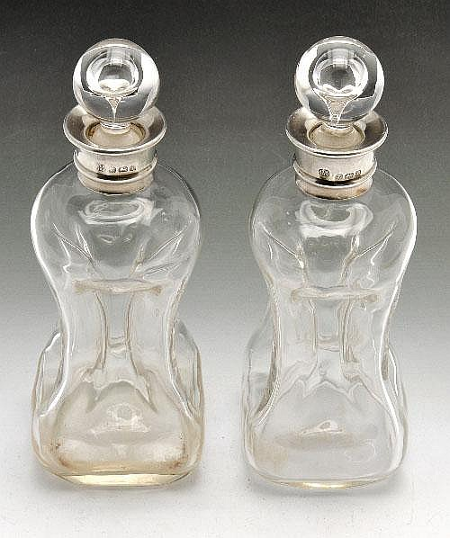 A pair of Edwardian silver mounted liqueur decanters.