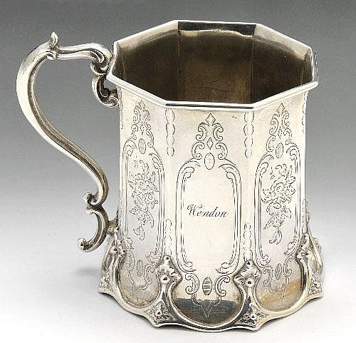 Victorian silver mug of tapered octagonal form.